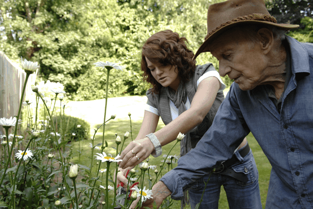 helping older gentleman at home with gardening
