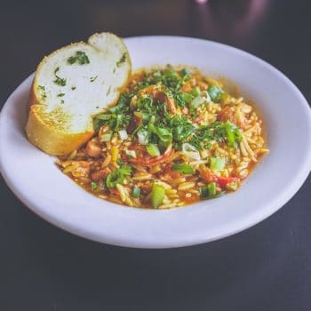 bowl of orzo pasta with vegetables