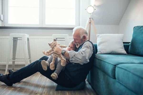 elderly man playing with grandchild